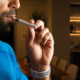 Man vaping CBD Oil stand for other ways to dose though too